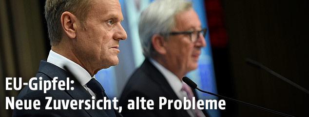 Ratspräsident Donald Tusk und im Hintergrund EU-Kommissionspräsident Jean-Claude Juncker