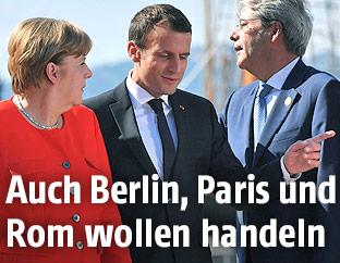 Die deutsche Kanzlerin Angela Merkel, Frankreichs Präsident Emmanuel Macron und der italienische Premierminister Paolo Gentiloni