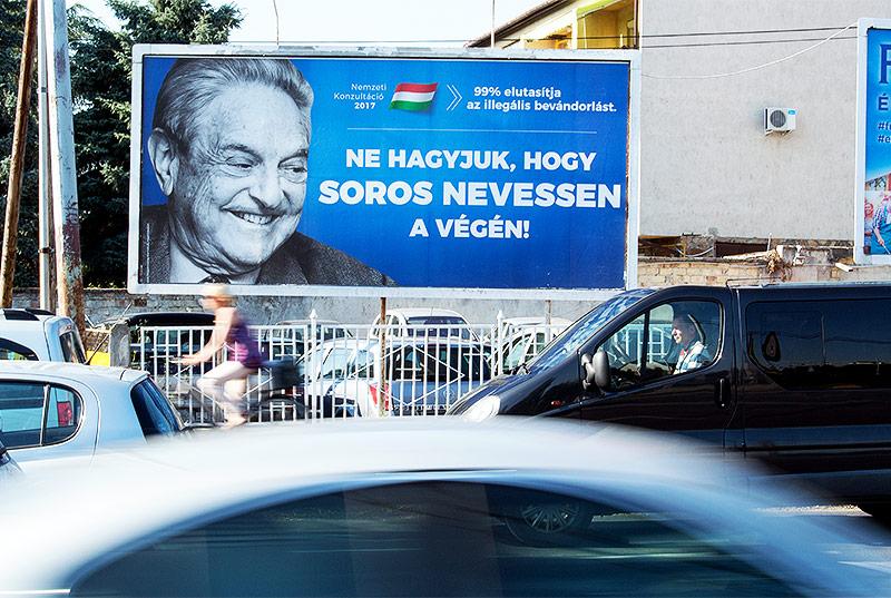 Plakat mit einem Bild von Investor George Soros