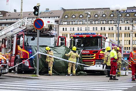 Feuerwehreinsatzkräfte am Tatort