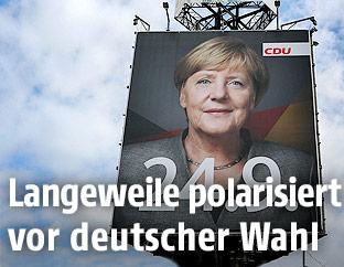 Ein Plakat mit der deutschen Kanzlerin Angela Merkel