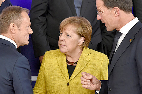 Donald Tusk, Angela Merkel und Mark Rutte