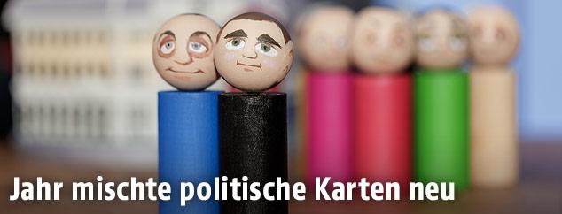 Figuren symbolisieren Parteiobleute