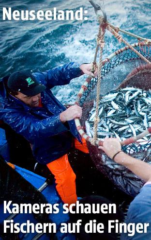 Fischer holen ihren Fang ein