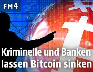 Mann zeigt auf ein Bitcoin-Logo