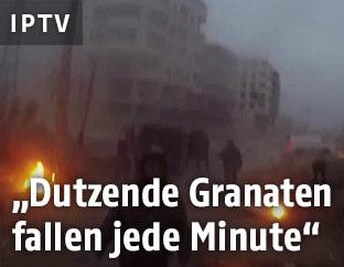 Menschen flüchten vor Luftangriffen in Ostghuta