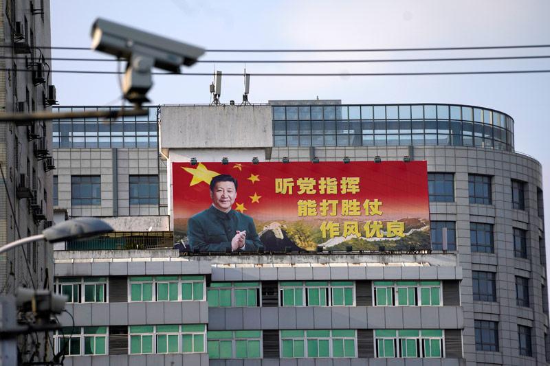 Plakat mit dem chinesischen Staatspräsidentn Xi Jinping