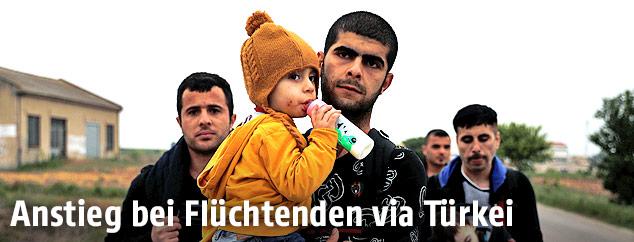 Syrischer Migrant mit Kind