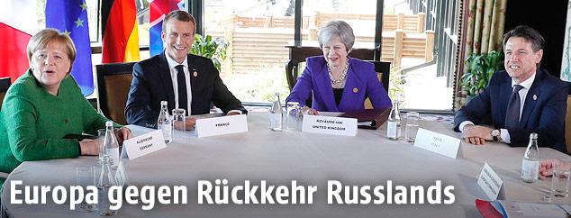 Deutsche Kanzlerin Angela Merkel, Frankreichs Präsident Emmanuel Macron, Britische Premierministerin Theresa May und Italiens Ministerpräsident Giuseppe Conte beim G-7-Gipfel in Quebec