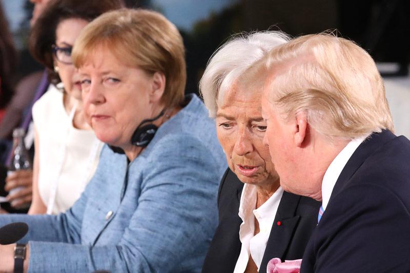 Angela Merkel, Christine Lagarde und Donald Trump