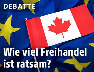 Kanada-Fahne liegt auf EU-Fahne