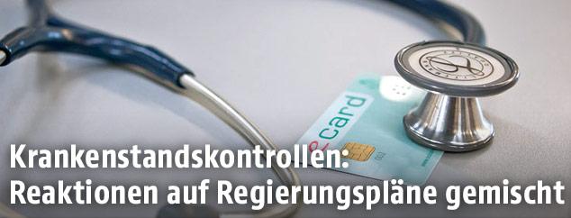 Stethoskop und eine E-Card