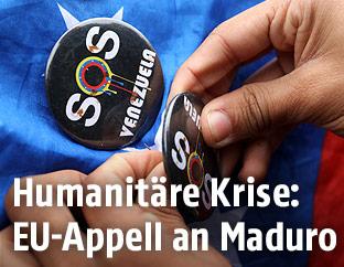 "Button zeigt ""SOS Venezuela"""