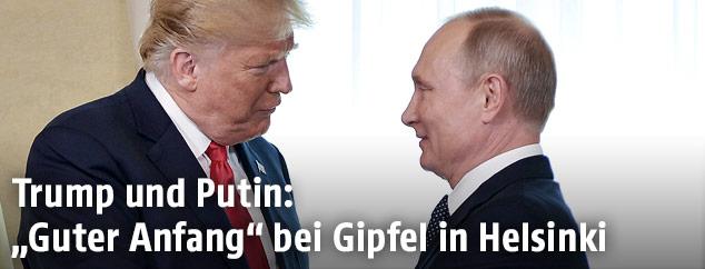 US-Präsident Donald Trump und Russlands Präsident Vladimir Putin schütteln die Hände