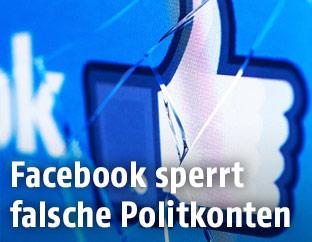 Facebook-Daumen auf kaputtem Display